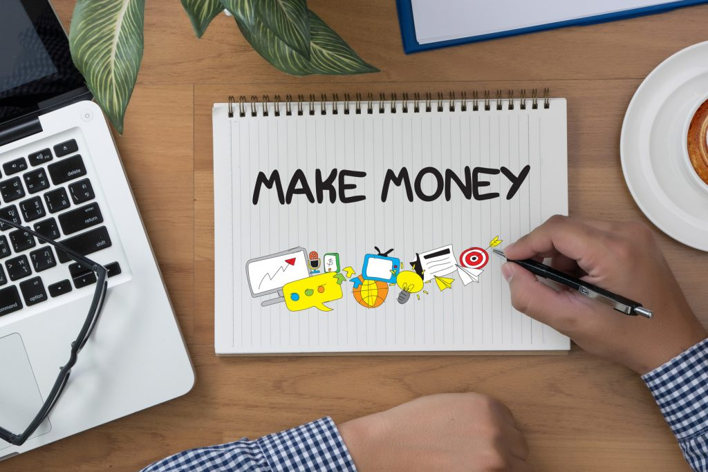 MAKE MONEY MAKE MONEY man hand notebook and other office equipment such as computer keyboard